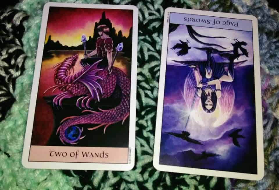Two of Wands Reversed Page of Swords