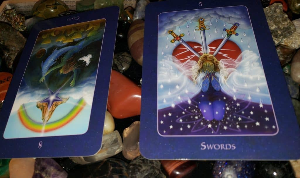 Eight of Cups rx, 3 of Swords